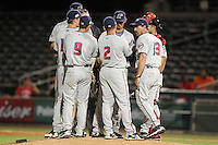 Fort Myers Miracle coach Steve Mintz #13 talks with (in order R-L) Daniel Santana #2, Levi Michael #9, Andy Leer #18, Michael Gonzalez #44, umpire Mario Seneca, Bruch Pugh #33, and Josmil Pinto #36 during a game against the Palm Beach Cardinals at Roger Dean Stadium on May 2, 2012 in Jupiter, Florida.  Fort Myers defeated Palm Beach 2-1.  (Mike Janes/Four Seam Images)