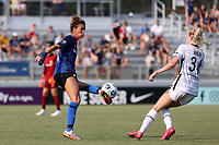 CARY, NC - SEPTEMBER 12: Carson Pickett #4 of the North Carolina Courage volleys the ball in front of Tyler Lussi #34 of the Portland Thorns FC during a game between Portland Thorns FC and North Carolina Courage at Sahlen's Stadium at WakeMed Soccer Park on September 12, 2021 in Cary, North Carolina.