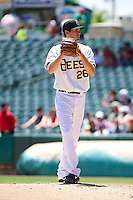 Caleb Clay (26) of the Salt Lake Bees delivers a pitch to the plate against the Nashville Sounds in Pacific Coast League action at Smith's Ballpark on June 22, 2014 in Salt Lake City, Utah.  (Stephen Smith/Four Seam Images)