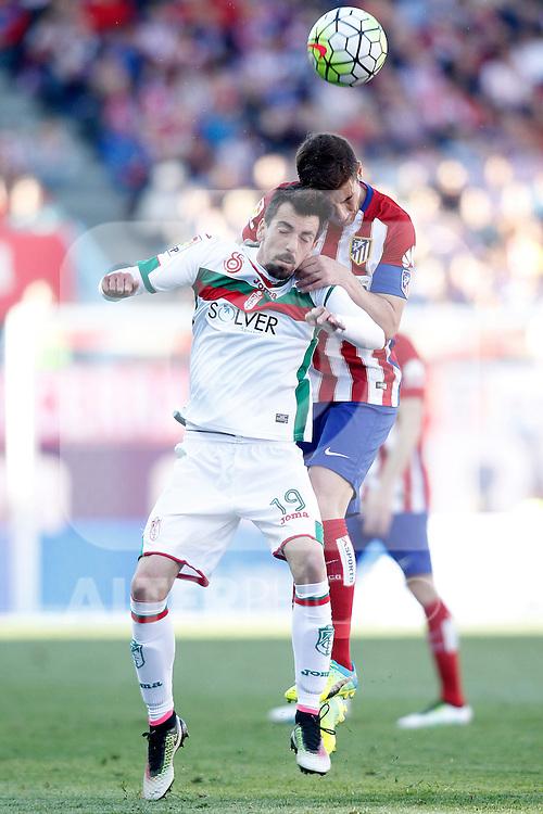 Atletico de Madrid's Gabi Fernandez (b) and Granada Club de Futbol's Isaac Cuenca during La Liga match. April 17,2016. (ALTERPHOTOS/Acero)