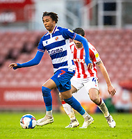 6th February 2021; Bet365 Stadium, Stoke, Staffordshire, England; English Football League Championship Football, Stoke City versus Reading; Michael Olise of Reading under pressure from Joe Allen of Stoke City