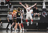 Pea Ridge guard Lauren Wright (12) blocks Prairie Grove Trinity Dobbs (14), Friday, January 8, 2021 during a basketball game at Pea Ridge High School in Pea Ridge. Check out nwaonline.com/210108Daily/ for today's photo gallery. <br /> (NWA Democrat-Gazette/Charlie Kaijo)