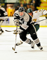 5 February 2011: Providence College Friar center Kyle MacKinnon, a Senior from Walnut, CA in action against the University of Vermont Catamounts at Gutterson Fieldhouse in Burlington, Vermont. The Catamounts defeated the Friars 7-1 in the second game of their weekend series. Mandatory Credit: Ed Wolfstein Photo