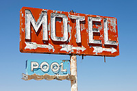 Sign for a Motel and pool along Route 66 in Yucca, Arizona, that no longer exists.