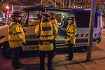 """© Joel Goodman - 07973 332324 . 15/12/2017. Manchester, UK. Police detain a man in a van on Sackville Street . Revellers out in Manchester City Centre overnight during """" Mad Friday """" , named for historically being one of the busiest nights of the year for the emergency services in the UK . Photo credit : Joel Goodman"""