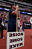 Houston, Texas<br /> October 2, 2011<br /> <br /> Watching from the sidelines as the players warm up and the game is about to begin. <br /> <br /> The Houston Texans defeated the Pittsburgh Steelers at the Reliant Stadium 17 to 10.