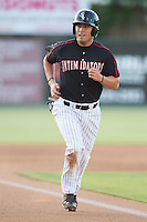 Nolan Early (9) of the Kannapolis Intimidators scores a run on a wild pitch during the game against the Delmarva Shorebirds at CMC-NorthEast Stadium on July 1, 2014 in Kannapolis, North Carolina.  The Intimidators defeated the Shorebirds 5-2. (Brian Westerholt/Four Seam Images)