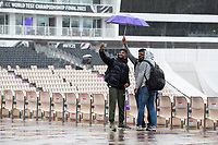 Stoic fans take a selfie as the rain continues to pour during India vs New Zealand, ICC World Test Championship Final Cricket at The Hampshire Bowl on 21st June 2021
