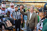 President George Bush performs the ceremonial coin toss before inaugural NCAA Football game at newly constructed McLean Stadium, Sunday, August 31, 2014 in Waco, Tex. Baylor leads SMU 31-0 in the first half. (Mo Khursheed/TFV Media via AP Images)