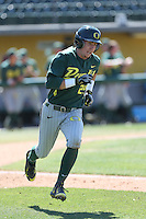 Mark Karaviotis (1) of the Oregon Ducks runs to first base during a game against the Southern California Trojans at Dedeaux Field on April 18, 2015 in Los Angeles, California. Oregon defeated Southern California, 15-4. (Larry Goren/Four Seam Images)