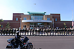 The procession for Carson City Sheriff's Deputy Carl Howell moves past the Sheriff's Office in Carson City, Nev., on Thursday, Aug. 20, 2015. Howell was shot and killed early Saturday morning after responding to a domestic violence call. (Cathleen Allison/Las Vegas Review-Journal)