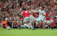Pictured: Joe Allen of Swansea (R) is pushed away by Mikel Arteta of Arsenal (L). Saturday 10 September 2011<br />