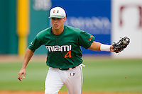 Shortstop Stephen Perez #4 of the Miami Hurricanes chases a runner back to first base at the 2010 ACC Baseball Tournament at NewBridge Bank Park May 27, 2010, in Greensboro, North Carolina.  The Eagles defeated the Hurricanes 12-10 in 10 innings.  Photo by Brian Westerholt / Four Seam Images