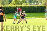 Greg Horan Austin Stacks and Michael Devlin Legion contest the loose ball  during their Snr Club Chamiponship clash in Killarney on Saturday