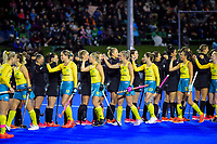 The players bump fists before the Sentinel Homes Trans Tasman Series hockey match between the New Zealand Black Sticks Women and the Australian Hockeyroos at Massey University Hockey Turf in Palmerston North, New Zealand on Tuesday, 1 June 2021. Photo: Dave Lintott / lintottphoto.co.nz