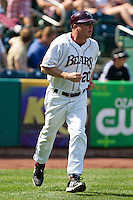 Coach Brent Thomas runs towards the first base side during a game against the Wichita State Shockers on April 9, 2011 at Hammons Field in Springfield, Missouri.  Photo By David Welker/Four Seam Images