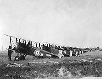 148th American Aero Squadron field.  Making preparations for a daylight raid on German trenches and cities.  The machines are lined up and the pilots and mechanics test their planes.  Petite Sythe, France.  August 6, 1918.  Lt. Edward O. Harris. (Army)<br /> NARA FILE #:  111-SC-18846<br /> WAR & CONFLICT BOOK #:  591