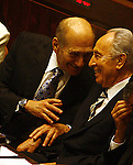 Newly elected Israeli president Shimon Peres smiles and  shares a light moment with Prime Minister Ehud Olmert  before wining the elections at the Knesset Israel's Parliament in Jerusalem Wednesday June 13 2007. Vice Premier Shimon Peres was elected Israel's ninth president Wednesday, capping a six-decade political career in which he has held every senior government post. Photo by Eyal Warshavsky