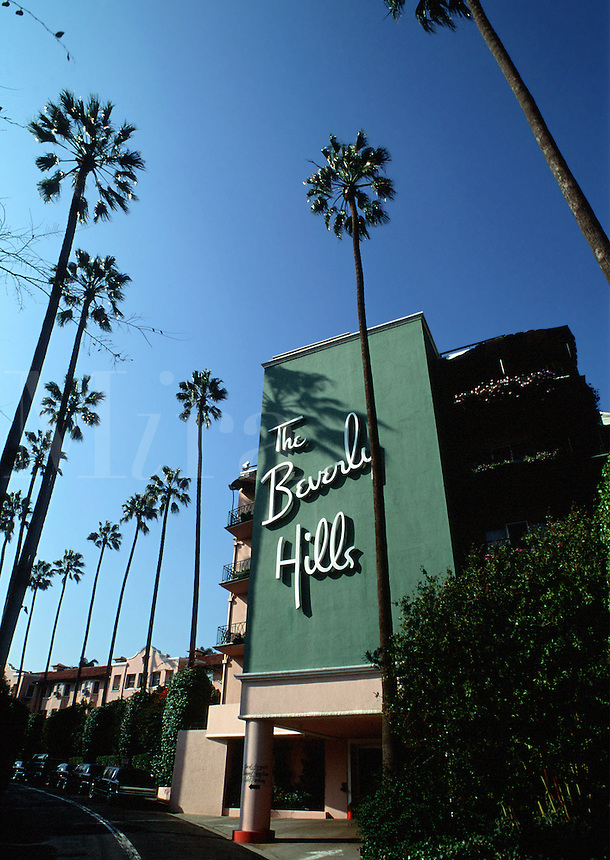 The exterior of the landmark Beverly Hills Hotel with palm trees. Los Angeles, California.