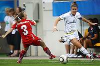 USA's Christine Nairn (R) and Sarah Steinmann of Switzerland during the FIFA U20 Women's World Cup at the Rudolf Harbig Stadium in Dresden, Germany on July 17th, 2010.
