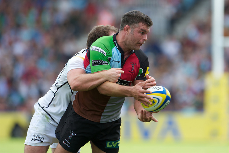 Nick Easter of Harlequins attempts to offload in the tackle during the Aviva Premiership match between Harlequins and Sale Sharks at The Twickenham Stoop on Saturday 15th September 2012 (Photo by Rob Munro)