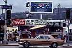 Joe's Big Burger stand on third at Edinburgh with classic Mustang passing circa 1978