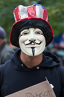 A man wears a Guy Fawkes mask of the group Anonymous during the Occupy Wall Street demonstration in New York City, New York.