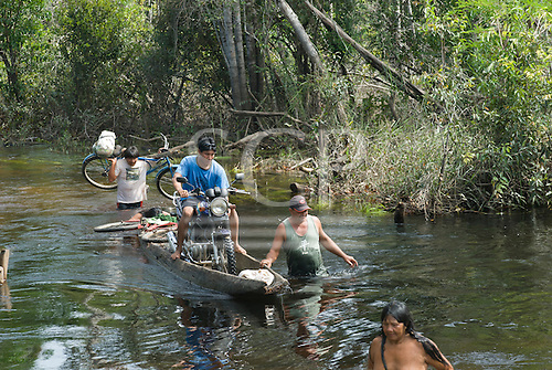 Xingu Indigenous Park, Mato Grosso State, Brazil. Aldeia Lahatua; path from the port to the village; fording the river - a dugout canoe ferry.