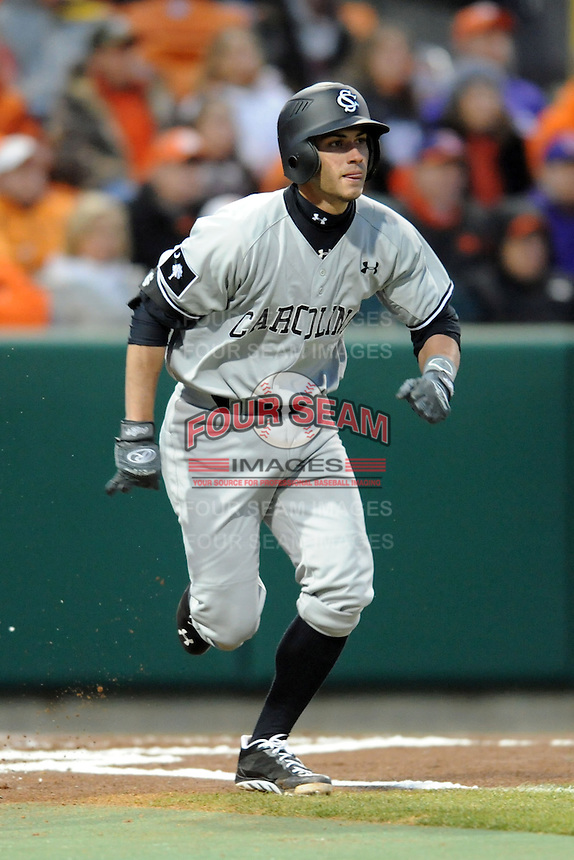 South Carolina Gamecocks third baseman Chase Vergason #16 runs to first during a game against the Clemson Tigers at Doug Kingsmore Stadium on March 1, 2013 in Clemson, South Carolina. The Gamecocks won 6-0.(Tony Farlow/Four Seam Images).