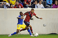 Danny Williams (7) of the United States is defended by Walter Ayovi (10) of Ecuador. The men's national team of the United States (USA) was defeated by Ecuador (ECU) 1-0 during an international friendly at Red Bull Arena in Harrison, NJ, on October 11, 2011.