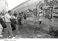 2/7/1987 Tour de France 1987.<br /> Stage 1 - Berlin to Berlin.<br /> Luis Herrera stands beside the Berlin wall.<br /> Photo: Offside / L'Equipe. COPYRIGHT WARNING : THIS IMAGE IS RIGHTS MANAGED AND THE COPYRIGHT MAY SIT WITH A THIRD PARTY PLEASE CONTACT simon@swpix.com BEFORE DOWNLOAD AND OR USE
