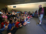 Gabe Kerschner, with the Wild Things program, teaches a large crowd about Samantha the lemur during a presentation at the Carson City Library, in Carson City, Nev., on Wednesday, July 30, 2014.<br /> Photo by Cathleen Allison