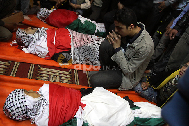 Palestinian mourners attend a funeral at a mosque in Gaza City on March 23, 2011 a day after eight Gazans were killed, among them two minors and four militants, as tensions soared on the border with Israel after days of rocket fire and retaliatory air strikes. Photo by Mohammed Asad