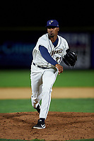 Tri-City Dust Devils relief pitcher Starlin Cordero (27) follows through on his delivery during a Northwest League game against the Vancouver Canadians at Gesa Stadium on August 21, 2019 in Pasco, Washington. Vancouver defeated Tri-City 1-0. (Zachary Lucy/Four Seam Images)