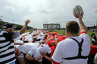 Pictured: The actual scrum attempt under way in Cardiff, Wales, UK. Wednesday 24 August 2016<br />Re: The largest rugby scrum has been achieved by Golden Oldies at University Fields in Cardiff south Wales, UK. It was refereed by welsh international referee Nigel Owens. Guinness World Records has verified the new record in which 1297 people took part in.