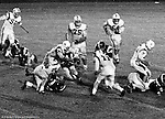 Bethel Park PA:  Defensive play with Mike Stewart 11 and Ray Tedesco 61 stopping the Highlander quarterback. Others in the photo; Don Troup 51, Joe Barrett 75, Dan Hannigan 64, Dennis Franks 66, Jim Dingeldine 73, Glenn Eisaman.  After Scott Streiner was injuried on the first play, the team rallied and came up just short of winning the game when they missed a two-point conversion late in the 4th quarter (7-6).  Defensive unit was one of the best in Bethel Park history only allowing a little over 7 points a game.