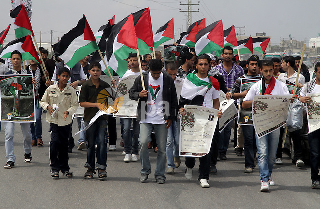 """Palestinian protesters gather clsoe to the Erez crossing in the northern Gaza Strip, on May 15, 2011, as people gathered to mark the """"nakbah"""" or """"catastrophe"""" anniversary of Israel's creation in 1948, as a result of which more than 760,000 Palestinians -- estimated today to number 4.7 million with their descendants -- were pushed into exile or driven out of their homes. According to medics 45 people were injured when the Israeli troops opened fire. Photo by Ali Jadallah"""