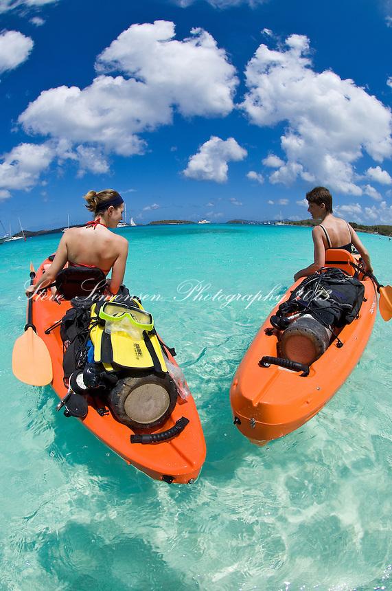 Kayakers with scuba equipment.St. John, US Virgin Islands
