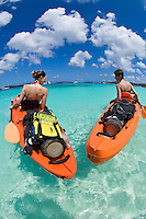 Kayakers with scuba equipment.St. John, US Virgin Islands