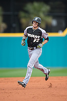 Robby Rinn (25) of the Bryant Bulldogs rounds the bases after hitting a home run against the Coastal Carolina Chanticleers at Springs Brooks Stadium on March 13, 2015 in Charlotte, North Carolina.  The Chanticleers defeated the Bulldogs 7-2.  (Brian Westerholt/Four Seam Images)