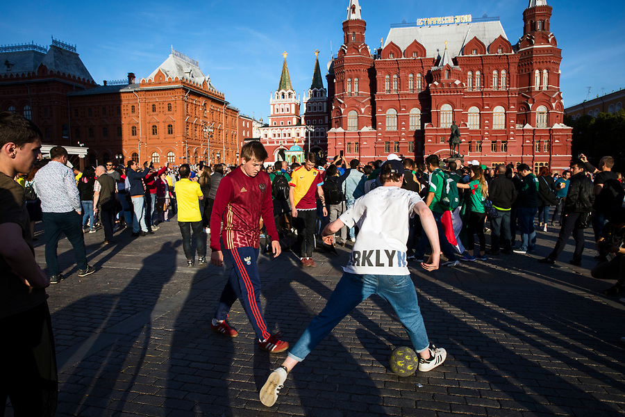 Moscow, Russia, 15/06/2018.<br /> Russian supporters play football by Red Square in central Moscow during the 2018 FIFA World Cup.