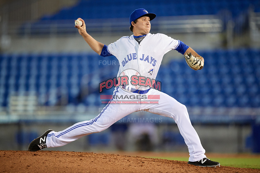 Dunedin Blue Jays relief pitcher William Ouellette (15) delivers a pitch during a game against the Fort Myers Miracle on April 17, 2018 at Dunedin Stadium in Dunedin, Florida.  Dunedin defeated Fort Myers 5-2.  (Mike Janes/Four Seam Images)