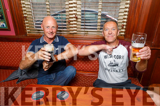 Old school mates Tony Burke and Michael Healy having a chat and a pint at the reopening of the Castle Bar on Monday.