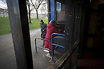 Edinburgh City v Spartans, 11/04/2015. Commonwealth Stadium, Scottish Lowland League. Spectators arriving at a turnstile at the Commonwealth Stadium at Meadowbank before the Scottish Lowland League match between Edinburgh City and city rivals Spartans, which was won by the hosts by 2-0. Edinburgh City were the 2014-15 league champions and progressed to a play-off to decide whether there would be a club promoted to the Scottish League for the first time in its history. The Commonwealth Stadium hosted Scottish League matches between 1974-95 when Meadowbank Thistle played there. Photo by Colin McPherson.