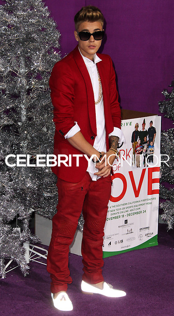 """LOS ANGELES, CA - DECEMBER 18: Singer Justin Bieber arrives at the World Premiere Of Open Road Films' """"Justin Bieber's Believe"""" held at Regal Cinemas L.A. Live on December 18, 2013 in Los Angeles, California. (Photo by Xavier Collin/Celebrity Monitor)"""