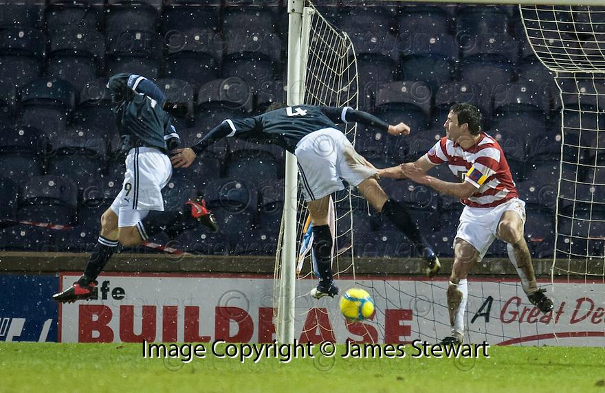 Raith's Brian Graham (9) deflects the ball into his own net.