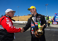 Jul. 27, 2014; Sonoma, CA, USA; Runner-up, V. Gaines (left) congratulates NHRA pro stock driver Jason Line after winning the Sonoma Nationals at Sonoma Raceway. Mandatory Credit: Mark J. Rebilas-