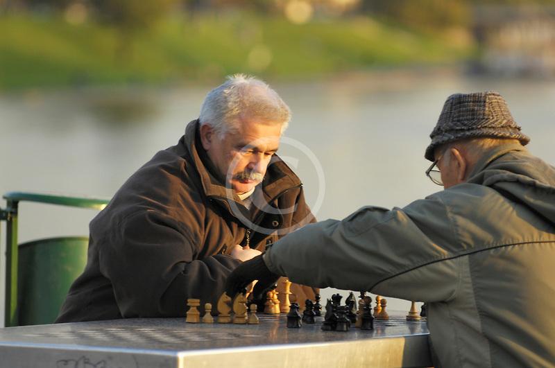 Poland, Krakow, Men playing chess