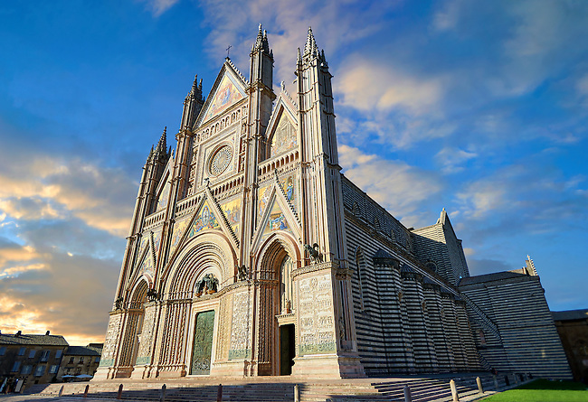 Three quarter view of the 14th century Tuscan Gothic style facade of the Cathedral of Orvieto, designed by Maitani, Umbria, Italy
