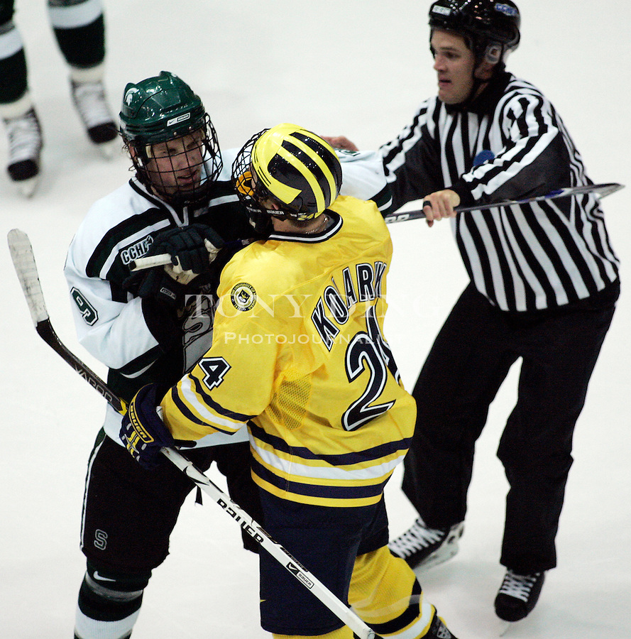 4 November 2006: MSU forward Justin Abdelkader (9) confronts Michigan forward Chad Kolarik (24), as a referee tries to break them up, during a CCHA conference ice hockey game between Michigan and in-state rival Michigan State, at Yost Ice Arena in Ann Arbor, MI. Michigan won the game 6-2.